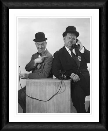 laurel hardy on the phone framed print