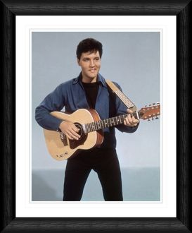 Elvis Presley with a Twelve String Guitar Framed Print