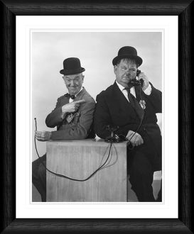 Laurel & Hardy on the Phone Framed Print