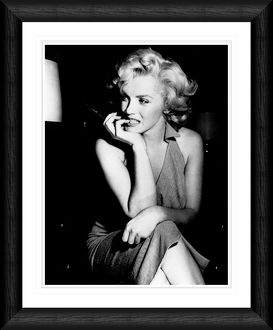Marilyn Monroe Candid Pose Holding a Cigarette Framed Print